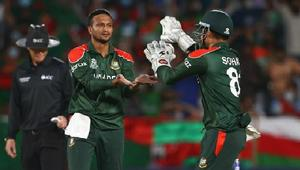 Bangladesh survive battle to reach Super 12