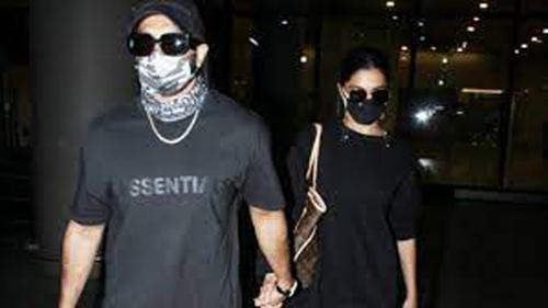 Deepika arrives back in Mumbai with husband