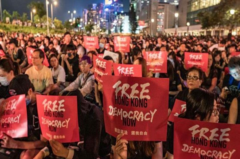 Hong Kong protest: police arrest 36, fire tear shells